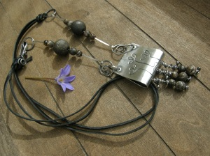 Sterling silver sheet and wire, leather lace, my own ceramic beads, turritella agate beads.