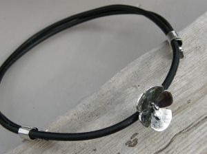 Sterling silver and leather.
