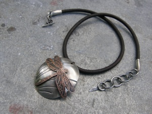 Patinated sterling silver and etched copper pendant, sterling silver closure, leather cord. waxed linen to fasten the pendant.