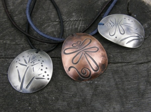 Sterling silver, copper (nickel free and lightly varnished), leather cord, waxed linen to fasten the pendants.