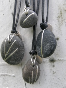 Stone, sterling silver, leather.