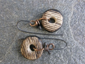Ceramic beads, bronze wire, titanium hooks.