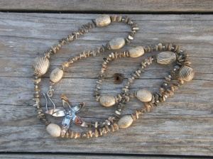 Bronze, silver, agate, mother-of-pearl, seed beads, on hemp cord.