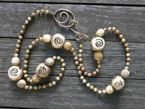 My ceramic beads, Picture Jasper, a few seed beads, on waxed linen cord, with my handmade bronze clasp.