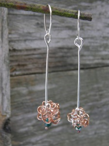 Sterling silver, bronze, glass bead.
